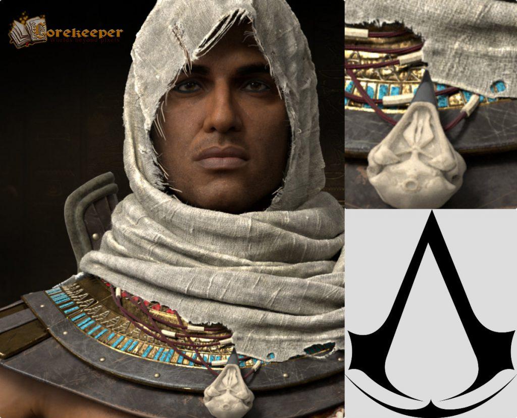 Bayek ve kartal kafatası şeklindeki kolyesinin Assassin sembolüyle bağlantısı netçe görülebiliyor.